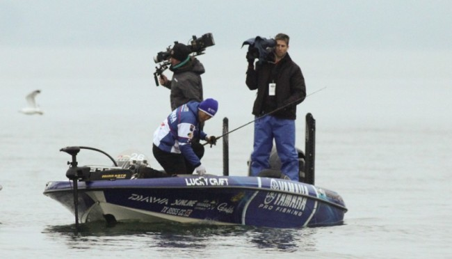 The one thing you can count on, the leader of a Bassmaster Classic will have plenty of cameras on him on the final day.   Photo: Steve Bowman
