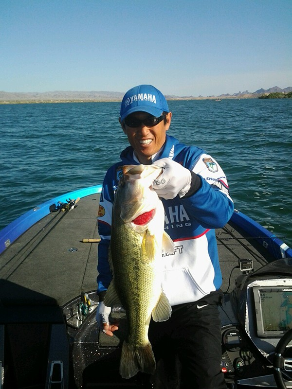 Takahiro Omori was already having a good morning with three keepers in the boat weighing about 8 1/2 pounds. It just got great. Omori landed a 6 1/2-pounder at 8:20 that gives him 15 pounds for the day and the lead in the tournament. Photo by Steve Wright