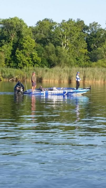 Takahiro Omori strolls by as Boyd Duckett holds onto the point he's fishing. Guarding it like a dog with a fresh bone. Update by Bassmaster Marshal Greg ledwell