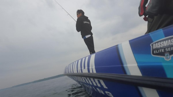 Takahiro Omori busy as the clouds roll in on St. Lawrence river. Photo by Bassmaster staff