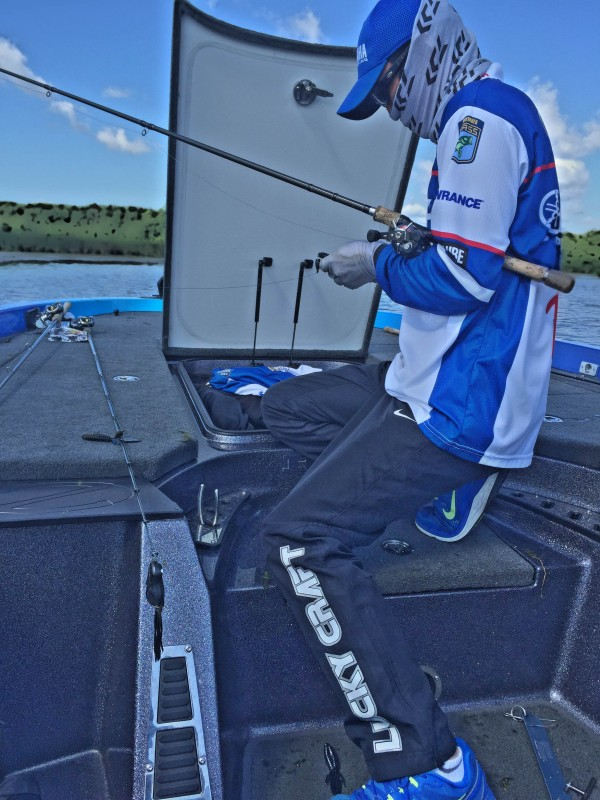 Takahiro Omori fine tunes his tackle for success. Photo by Bassmaster staff