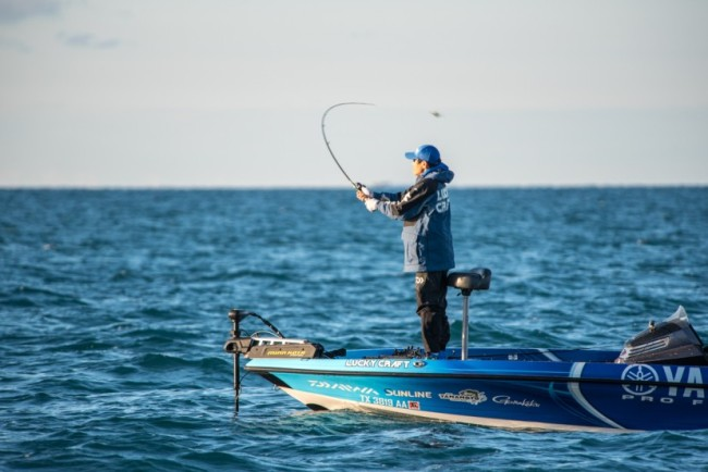 Tak throws his bait back towards the spot he thinks the fish are holding in. Photo: Garrick Dixon