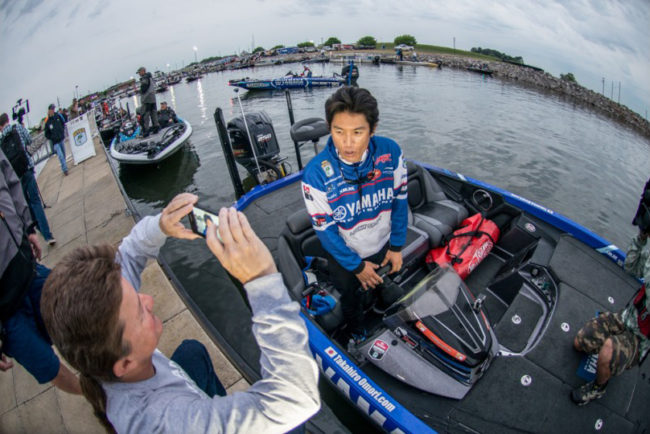 After a monster Day 2 bag Takahiro Omori does an interview for Facebook while in line to head out for Day 3. Photo: Garrick Dixon